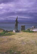Ph00015346c - Statue of General MacArthur stands at the site of the north dock, Corregidor, where he
