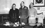 "Lt. Cmdr. Charles ""Chick"" Parsons, General MacArthur, and Captain Charles M. Smith in MacArthur's of"