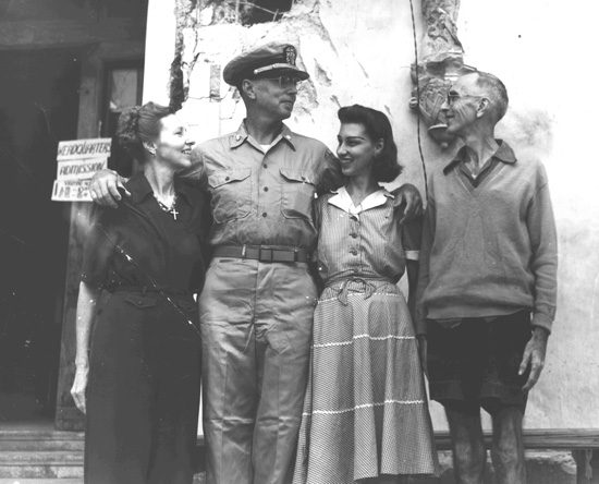 Lt. Commander Fred Worcester poses with his sister Alice and her recently liberated family.